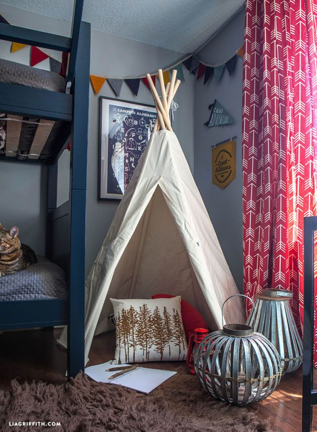 This adorable bedroom even has a teepee to go with its camping theme.