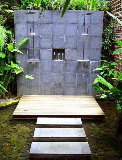 I love this outdoor shower - it even will recycle back to the pond!