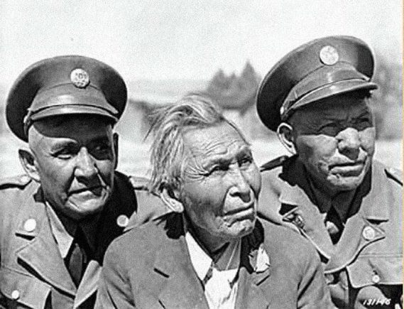 Army Code Talkers - Left to Right: Corporal Jim Lane, John Rope, and Kassey Y-32. Ft. Huachuca, Arizona, 1942.