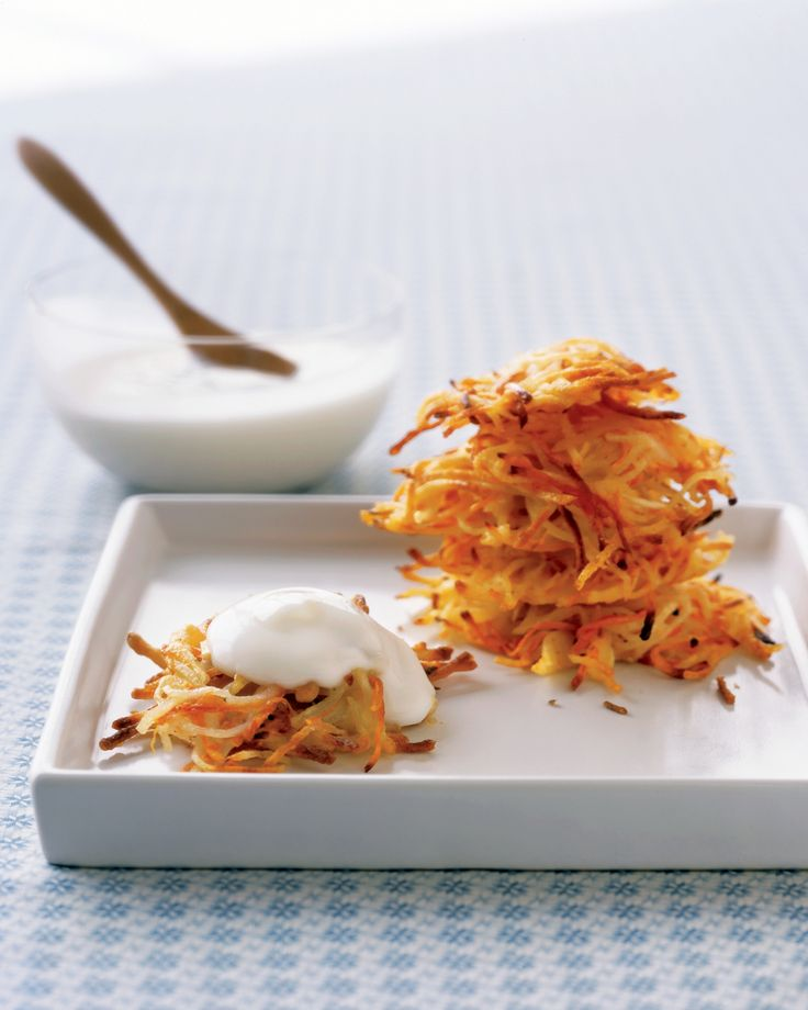 Carrot-and-Potato Latkes | Martha Stewart Living - For sweetness and color (as well as beta carotene), carrots have been added. Traditional latkes are deep-fried in oil, but these lighter latkes are panfried, then finished in a hot oven until they are crispy.