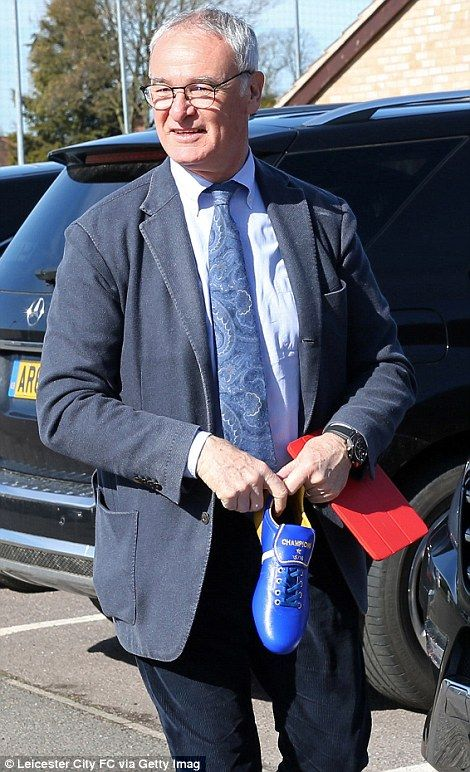 Back to work: Ranieri (pictured holding a 'Champions' football boot) arrived at Leicester'...