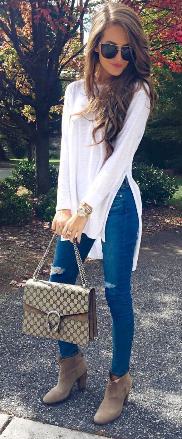 White loose long sleeve shirt. Blue skinny jeans. Tan booties, or one strap high heel.
