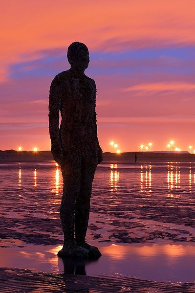 Antony Gormley - Another Place - an art installation of metal statues of Antony at Crosby Beach, Liverpool, UK