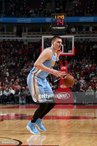 News Photo : Nikola Jokic of the Denver Nuggets handles the...