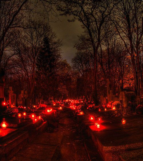 candels at night in a cemetery