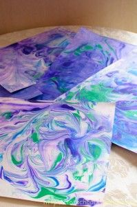 "shaving cream marble paper.  I did this with my class last year for Mother's Day.  I cut them into 4 pieces to make notecards.  Hint:  Make sure the kids ""swirl""- not stir.  The ones that didn't swirl turned out grey."