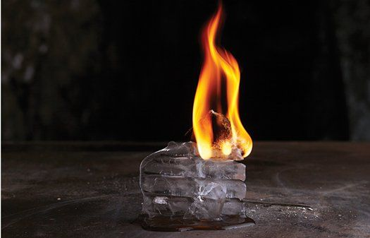 Fire and Ice: Calcium carbide on top of ice cubes generates enough acetylene to keep a flame going until the ice is completely melted.