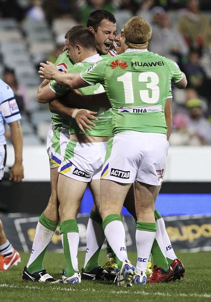 2013 Round 26 Canberra Raiders V Sharks: David Shillington of the Raiders is congratulated after scoring a try.