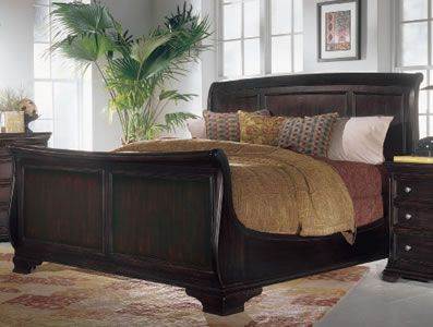 Sleigh Bed.  Would do a tropical theme comforter with palm leaves and some orange bird of paridise.
