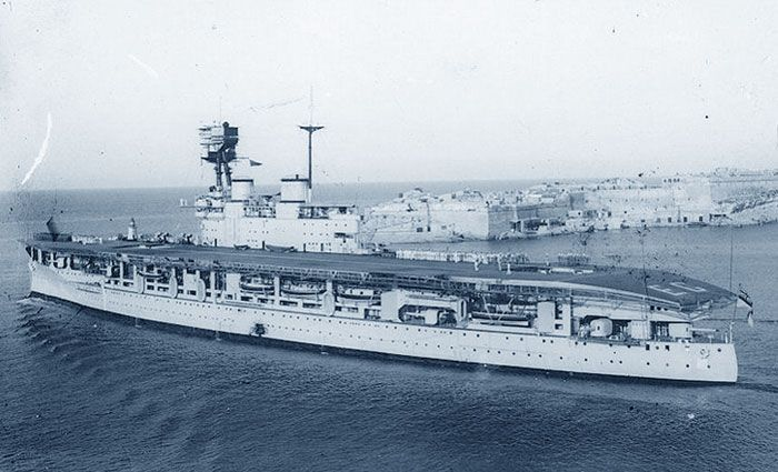Carrier HMS Eagle at Malta in 1935. Ordered from Britain as a Chilean battleship, she was purchased by the Royal Navy before completion in 1918 and entered service as one of the earliest carriers in 1922. She was torpedoed and sunk in August 1942 by a U boat whilst covering the famous 'Pedestal' Malta relief convoy.