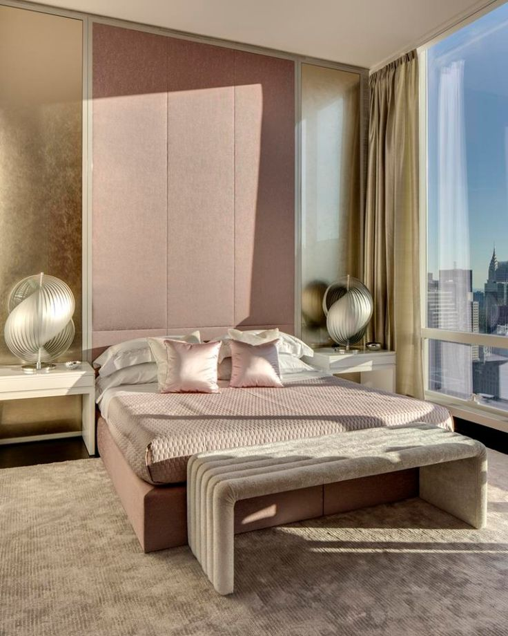 Beautiful bedrooms all belong to the same Apartment in Manhattan. The designs seem more modern with the use of metallic textiles and light pink tones that provide a space-age feel to it.