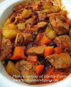 Philippine Pork Menudo is made of stewed pork and liver cubes in tomato sauce with potatoes, carrots, raisins, chickpeas, etc.