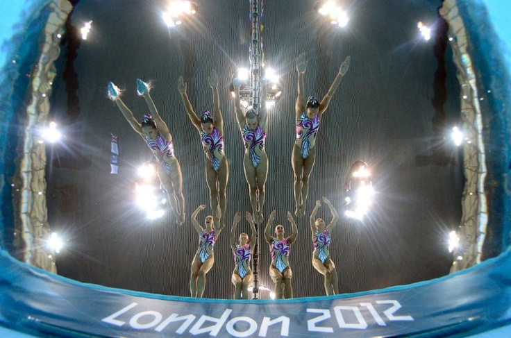 Team Great Britain enters the water during the synchronized swimming competition.