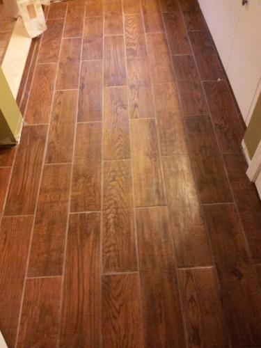 Home dept wood lookalike -   http://www.homedepot.com/p/MARAZZI-Montagna-Gunstock-24-in-x-6-in-Glazed-Porcelain-Floor-and-Wall-Tile-14-53-sq-ft-case-ULG4/203600163?N=c53u#BVRRWidgetID