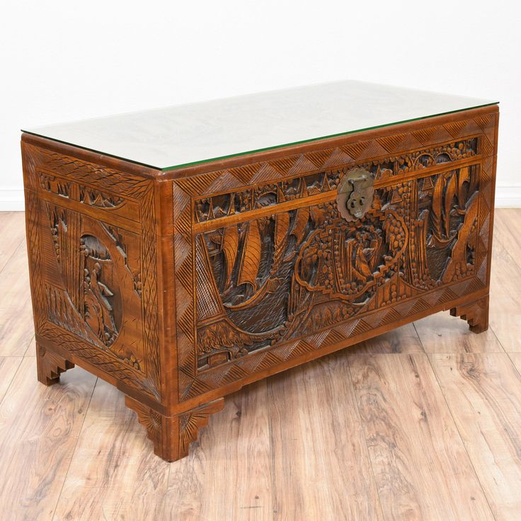 This asian inspired chest is featured in a solid wood with a glossy cherry finish. This trunk is in good condition with a durable glass top, a large interior cabinet space and intricate carved asian motifs. Perfect as a unique coffee table or blanket chest! #asian #storage #chestortrunk #sandiegovintage #vintagefurniture