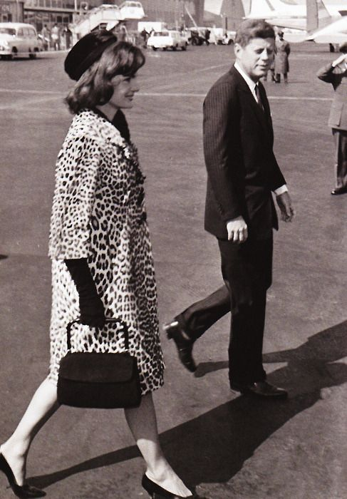 John and Jackie at the airport -- Grace, style and beauty..That of which is Jackie Kennedy. And JFK was a total fox!