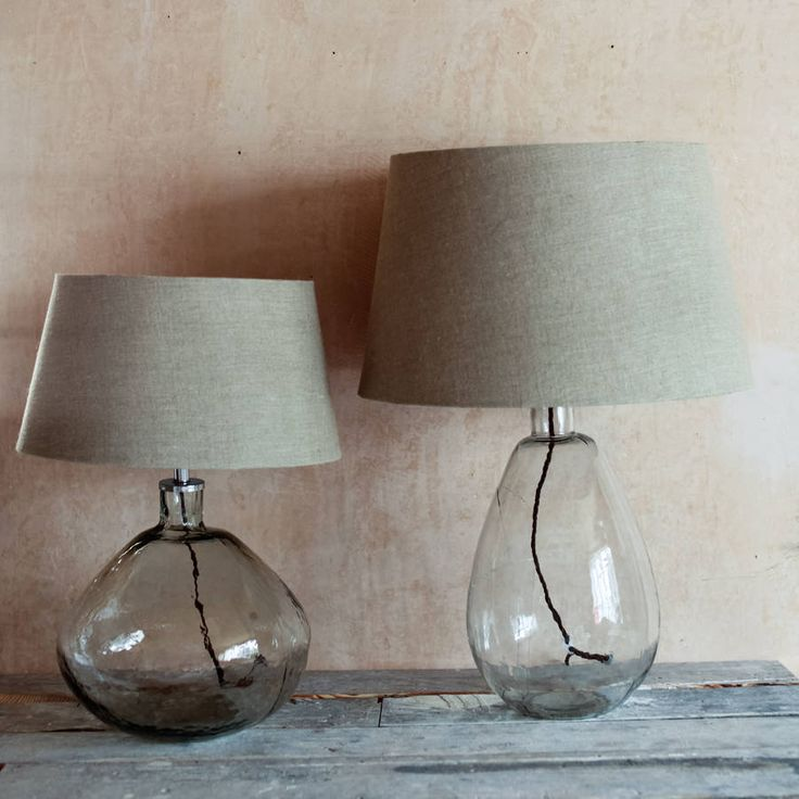 These beautiful glass lamps have been handmade by skilled artisans in Rajhasthan.Colour: Clear Glass with a braided cable in RustEach lamp is handmade from recycled glass with a finish is imperfect and textured. The hand made nature of the process gives the glass character. The lamp is available is two different styles: Wide and Tall. Both would look superb on a bedside table or even as a focal point as a table lamp in a lounge or dining area. Please note that the lamp is not provided with…