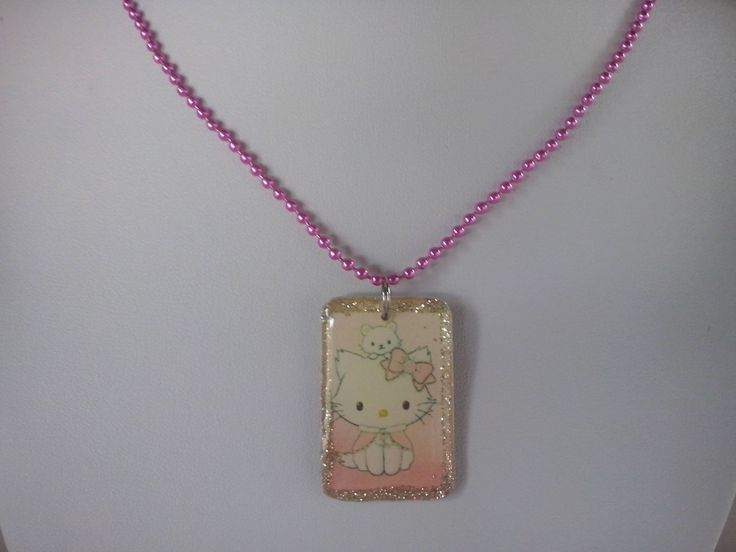 Beautiful Hello Kitty kid Pendant on a fuchsia ball chain!  ❋Photo paper pendant with clear resin and glitter https://www.etsy.com/listing/586891265/hello-kitty-necklace-girl-gift-kids?ref=shop_home_active_1