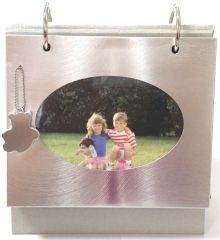 This photo frame album can hold 37 pictures of your favourite cuties!  Put a special photo in the aluminium frame cover and use the remaining 36 pages of the album to continue the story.
