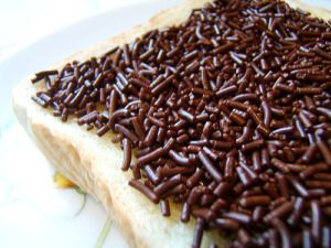 """Hagelslag - These are candy (chocolate pictured here) sprinkles the Dutch like to eat on a broodje (bread roll) or a slice of bread, which in this case they call a """"boterham"""".  They spread butter onto the bread and then sprinkle away."""