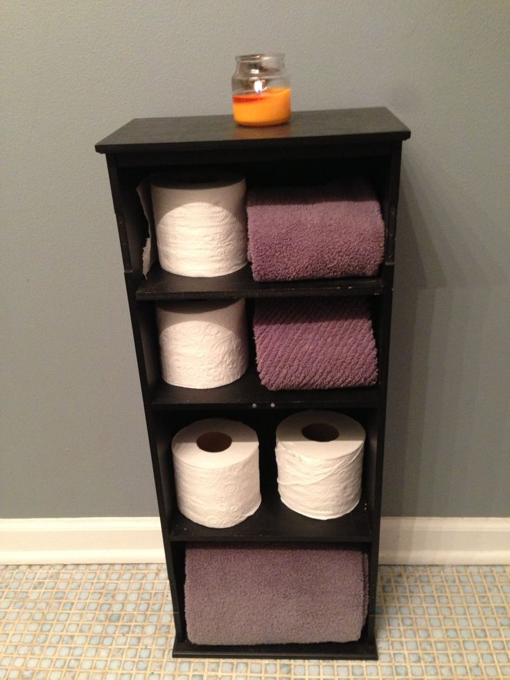 Repurposed DVD stand as a toilet paper/towel holder.