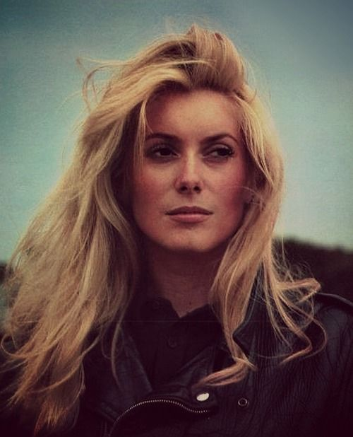 Catherine Deneuve, love this unexpected pic of her looking edgy that face, its perfect.