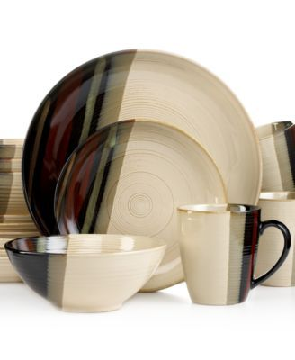 Sango Alpha White 16-Piece Set $49.99 Streaks of deep, earthy tones create an artfully dynamic, yet comforting look over cream-glazed stoneware in the Alpha collection from Sango. Its simple lines and rounded shapes give this set an ideal, transitional design.