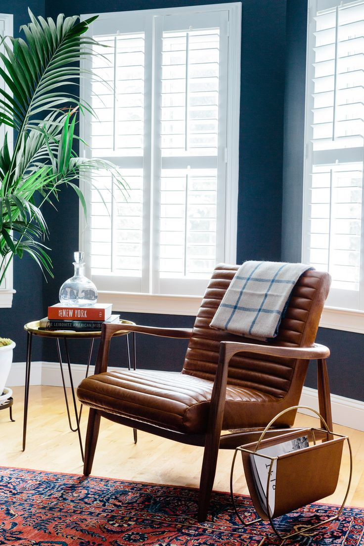 "We're a big fan of this <a href=""http://www.roomandboard.com/catalog/living/chairs/callan-chair-and-ottoman-in-lagoon-leather?an=0_185502&qa=0_CALLAN_CH_FRAME_FINISH_2%7CWA&qa=0_CALLAN_LAGOON_COLORWAYS%7CLC11&iCamp=pinterest_prod&utm_campaign=pinterest_prod&utm_source=prod_page&utm_medium=social "" target=""_blank"">Room and Board armchair</a>."