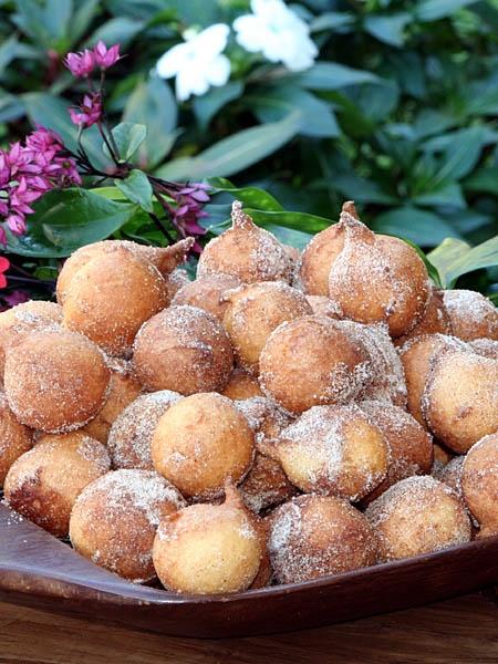 Bolinho de chuva - brazilian sweets. What is it: Little balls of glorious fried dough sprinkled with sugar and cinnamon. Tastes like: Cinnamon doughnut holes.