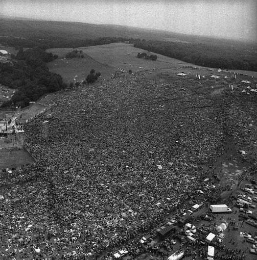 "Crowds gather at Woodstock Festival in Bethel, New York, for ""three days of peace and music"" in August 1969."