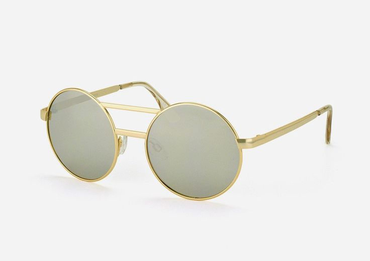 Vertigo Sunglasses by Le Specs. This round update on the classic aviator style features fine metal detailing and is finished in textured brushed gold. Made to suit every style, keep chic with this contemporary pair! http://www.zocko.com/z/JKCLf