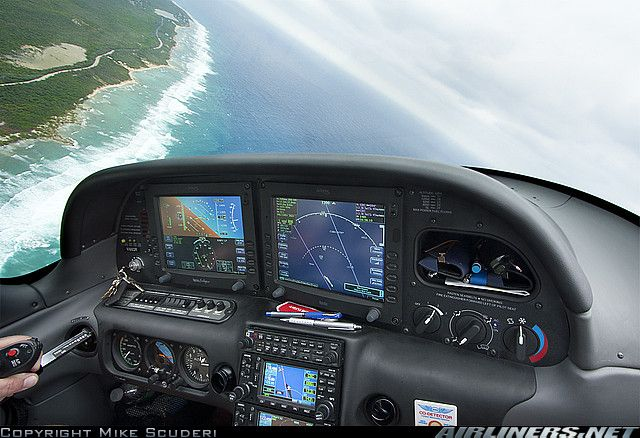 Photo from cockpit of Cirrus SR-22 -- overlooking little Cayman Island.