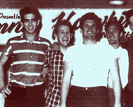 "Ronnie Hawkins (front) and The Hawks. Left to Right: Will ""Pop"" Jones (piano); Levon Helms (drums); Ronnie Hawkins (lead singer); Jimmy Evans (bass); J.R. Paulman (lead guitar)."