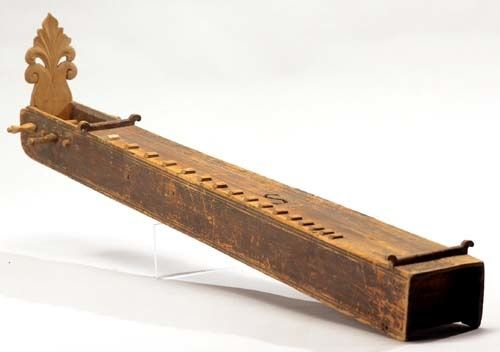The Langeleik also called langleik, is a Norwegian stringed folklore musical instrument resembles the Appalachian dulcimer, except it is played flat on the ground, not upright. The langeleik has one melody string in addition to eight drone strings.