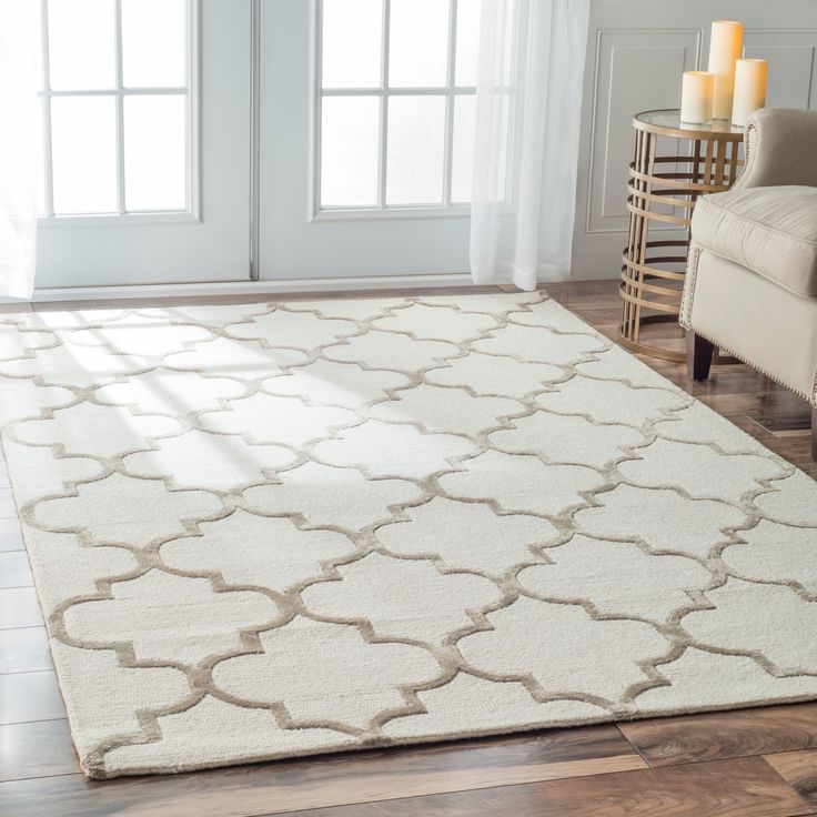 This hand made wool with highlights of faux silk area rug uses subtle and modern colors to match today's interiors. The plush wool pile offers great comfort under foot.