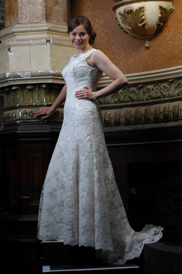 Desdemona- corded lace with a semi fitted skirt with train
