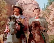 "Pee-wee's Playhouse is an American children's television program starring Paul Reubens as the childlike Pee-wee Herman. Cowboy Curtis (Laurence Fishburne) and Pee-wee on the 1990 episode ""Camping Out."""