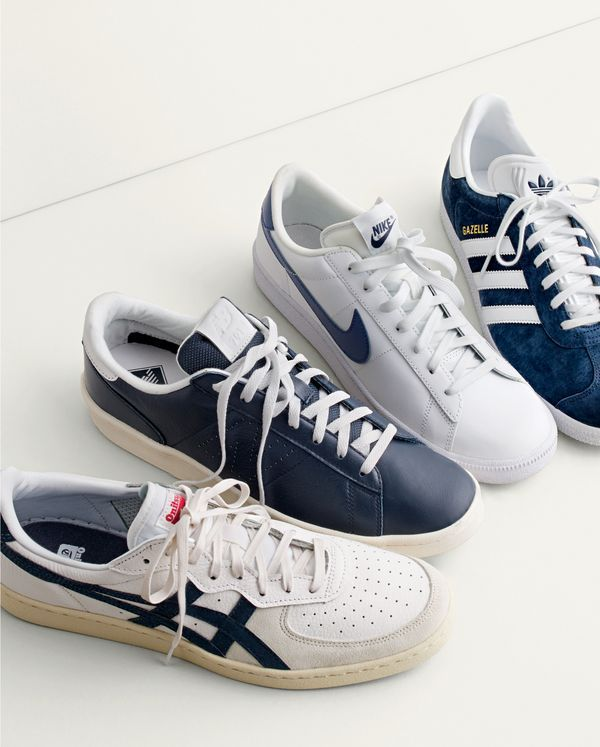 Retro and office ready. Combining classic designs with understated colorways, these leather sneakers from Nike®, Adidas®, New Balance® and Onitsuka Tiger® have proven they're ready for a position at your office.