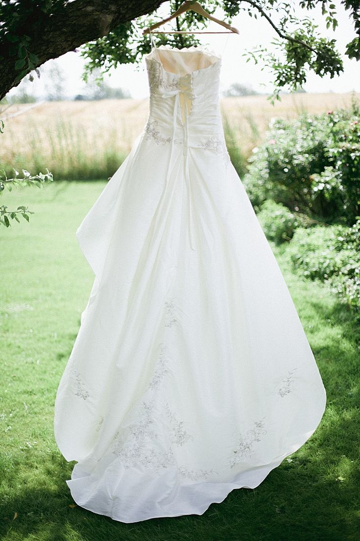 outdoor dress shot by camilla jorvad. photographed in the garden at b&b bakkehuset, aeroe, denmark