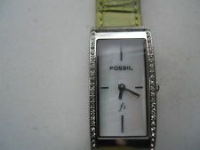 Fossil women's green leather band.quartz,battery & Analog dress used watch..