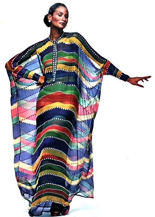 Beverly Johnson wearing a striped caftan by Pauline Trigère, 1974