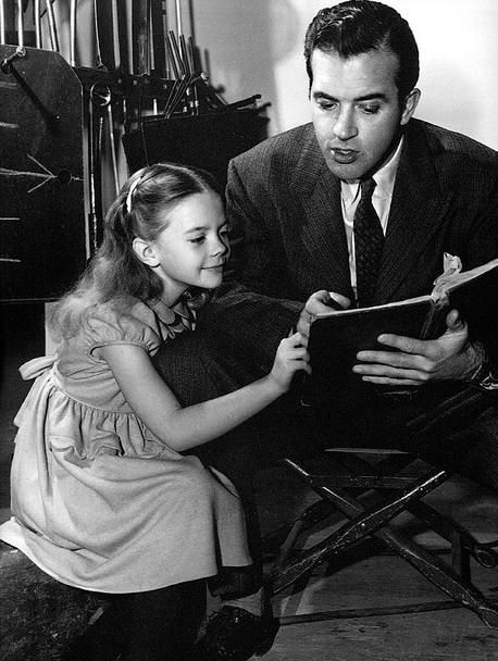 Natalie Wood and John Payne rehearsing lines for Miracle On 34th Street 1947