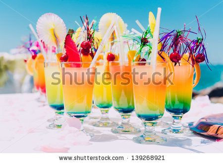Tropical cocktails on the beach - Shutterstock Premier