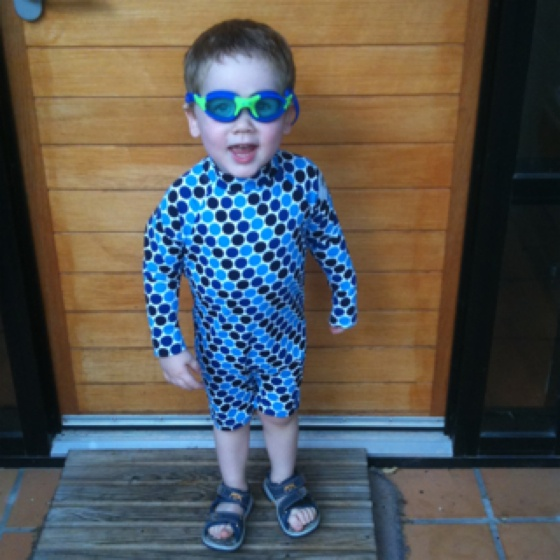Cutest boy in the world! (yes he's my son) I love the contrast between the spots on his swimsuit and the lines on the door.