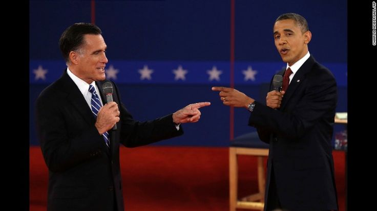 """Obama faces off with Mitt Romney at a presidential debate in Hempstead, New York, on October 16, 2012. Obama <a href=""""http://www.cnn.com/2012/11/06/politics/election-2012/"""" target=""""_blank"""">was re-elected</a> with 332 electoral votes to Romney's 206."""