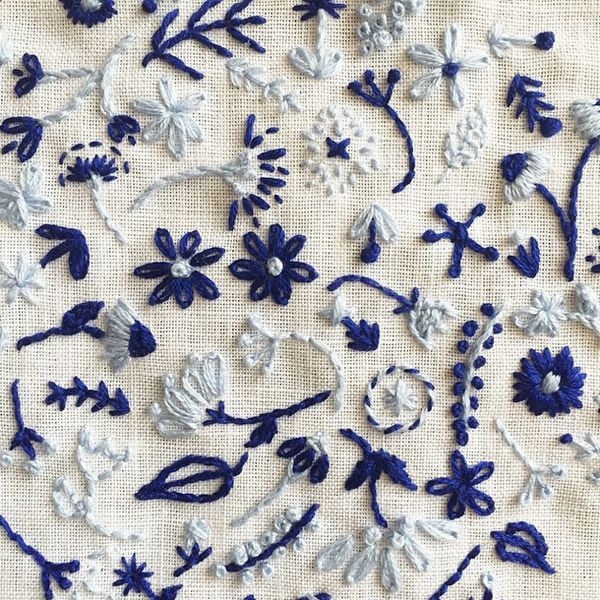 Blue embroidery in detail by Happy Catcus Designs (via Oh So Beautiful Paper).