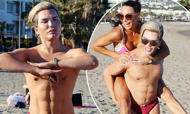 Human Ken Doll Rodrigo Alves flashes his £22k FAKE abs