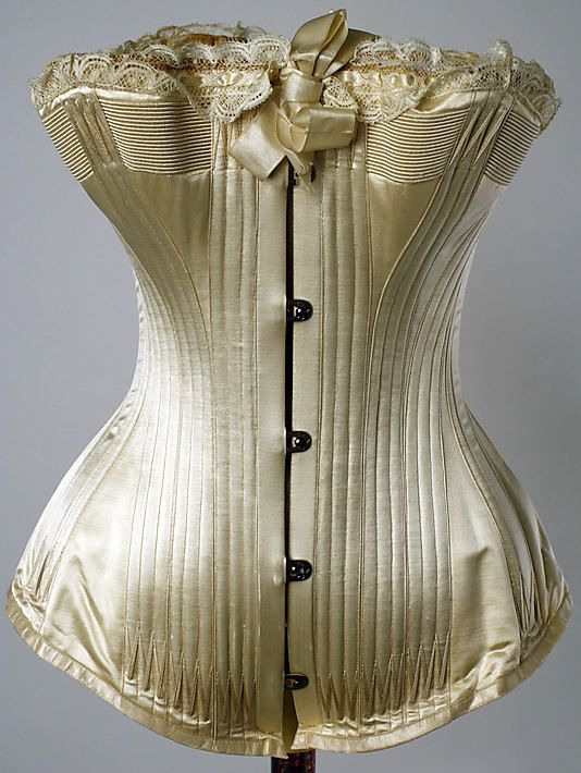 Corset  Date: mid-1880s Culture: American Medium: silk, cotton, metal Dimensions: Length at CB: 13 1/4 in. (33.7 cm)