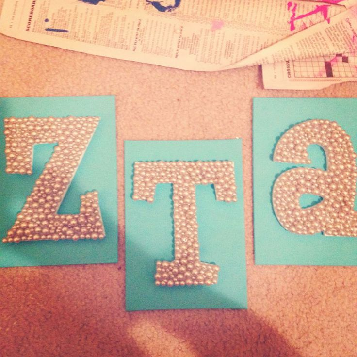 Cute idea to put pearl ZTA letters on painted canvas.