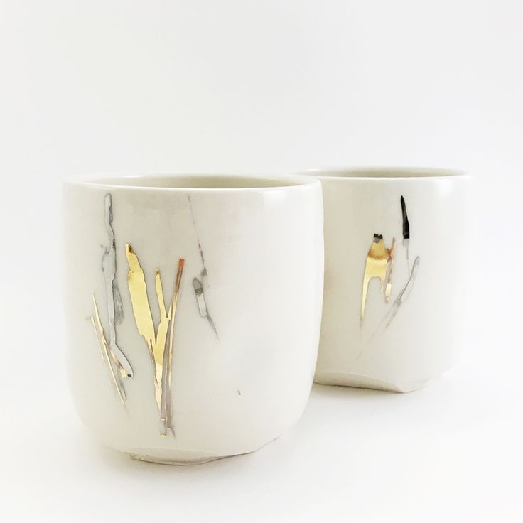 silver and gold altered tumbler -  glazed porcelain with white gold, and yellow gold abstract marks.